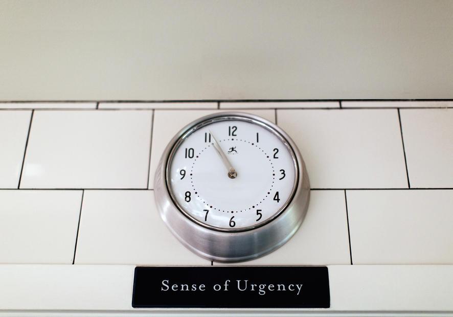 Wall clock; sense of urgency sign