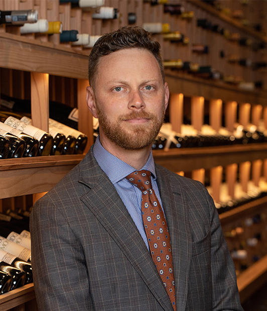 Portrait of Andrew Adelson in The French Laundry Wine Cellar
